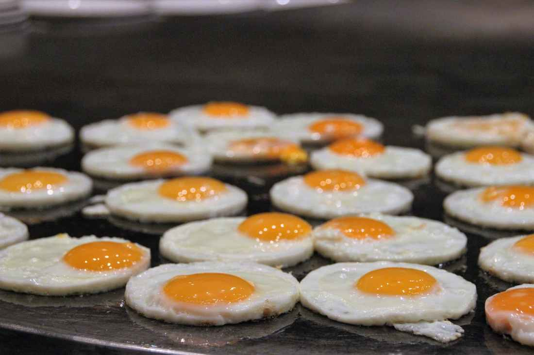 cooking eggs food fried eggs