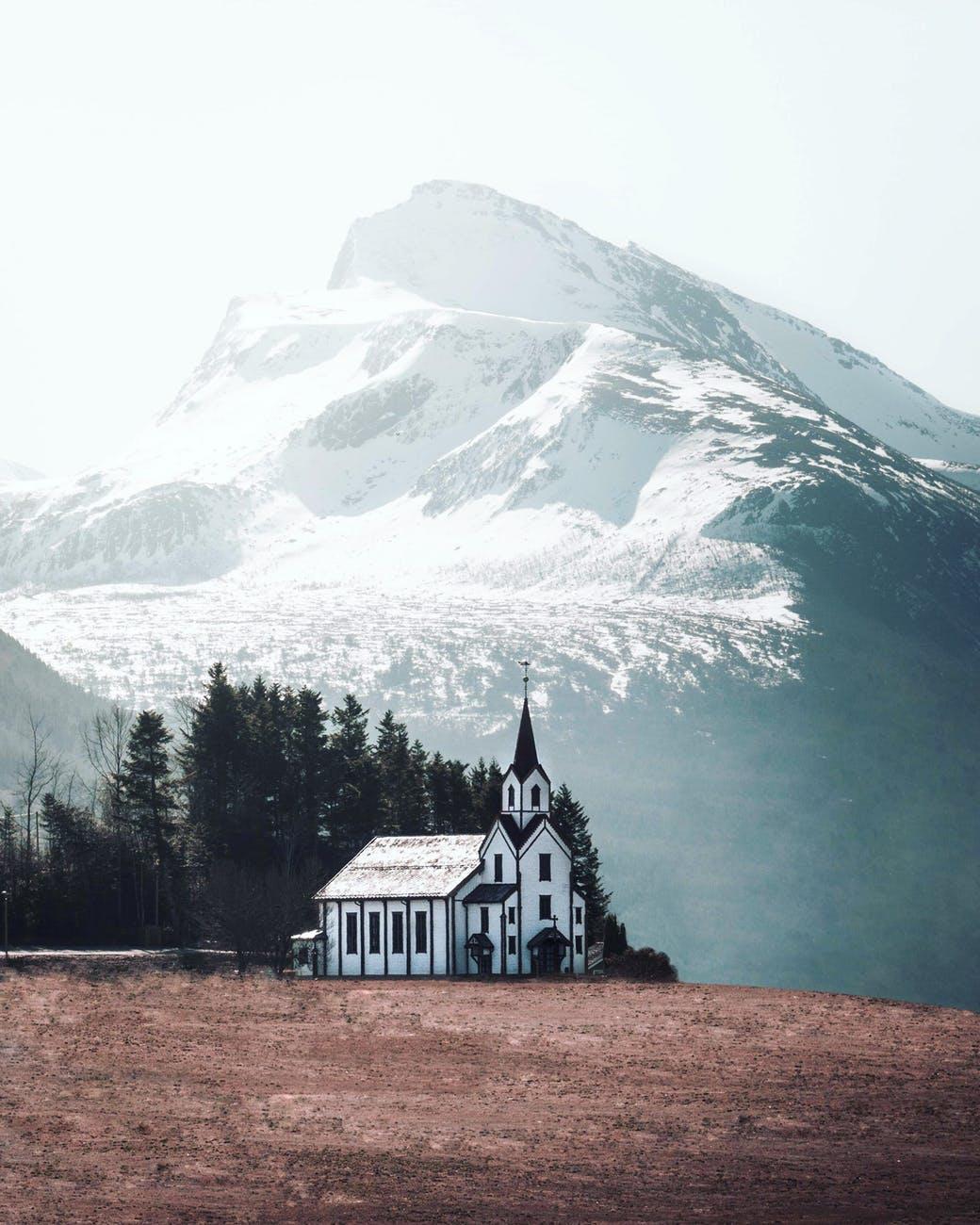 white and black church photo across white mountain