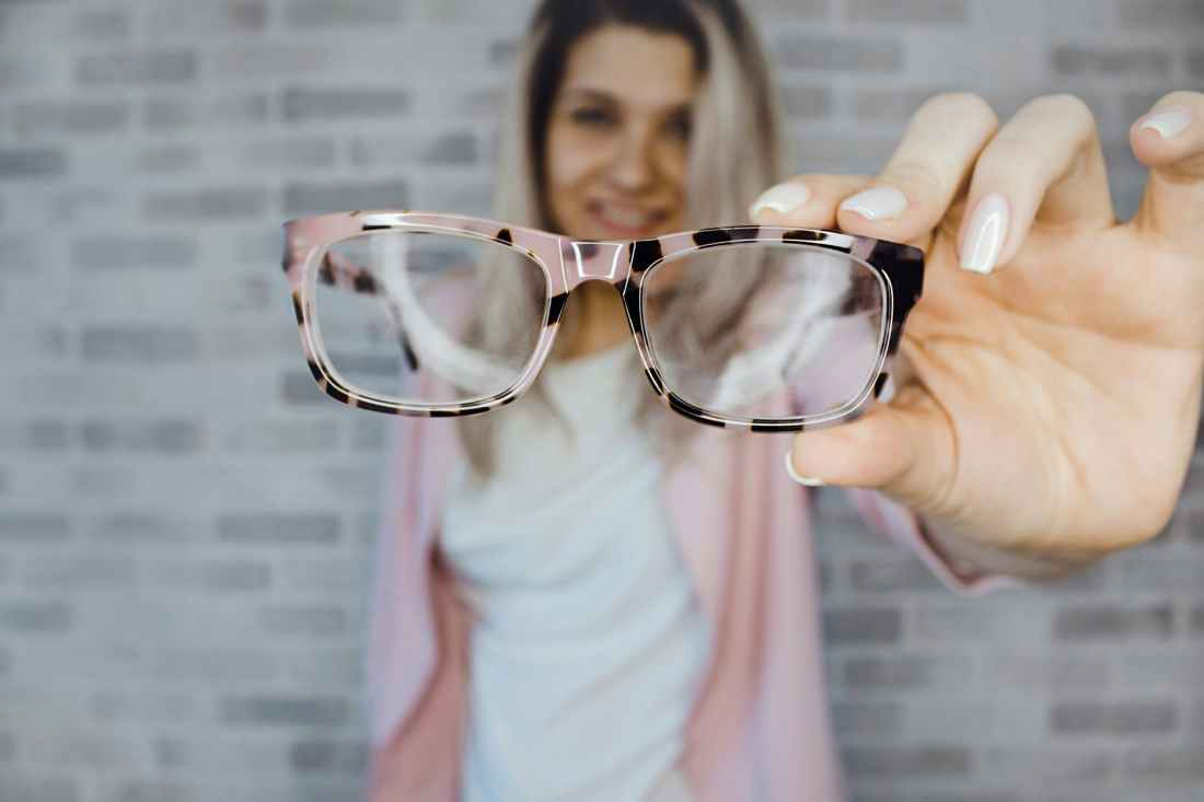 selective focus photography of pink and black framed eyeglasses