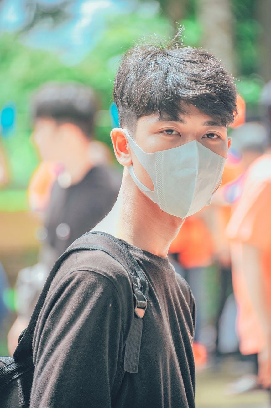 photo of man wearing mask