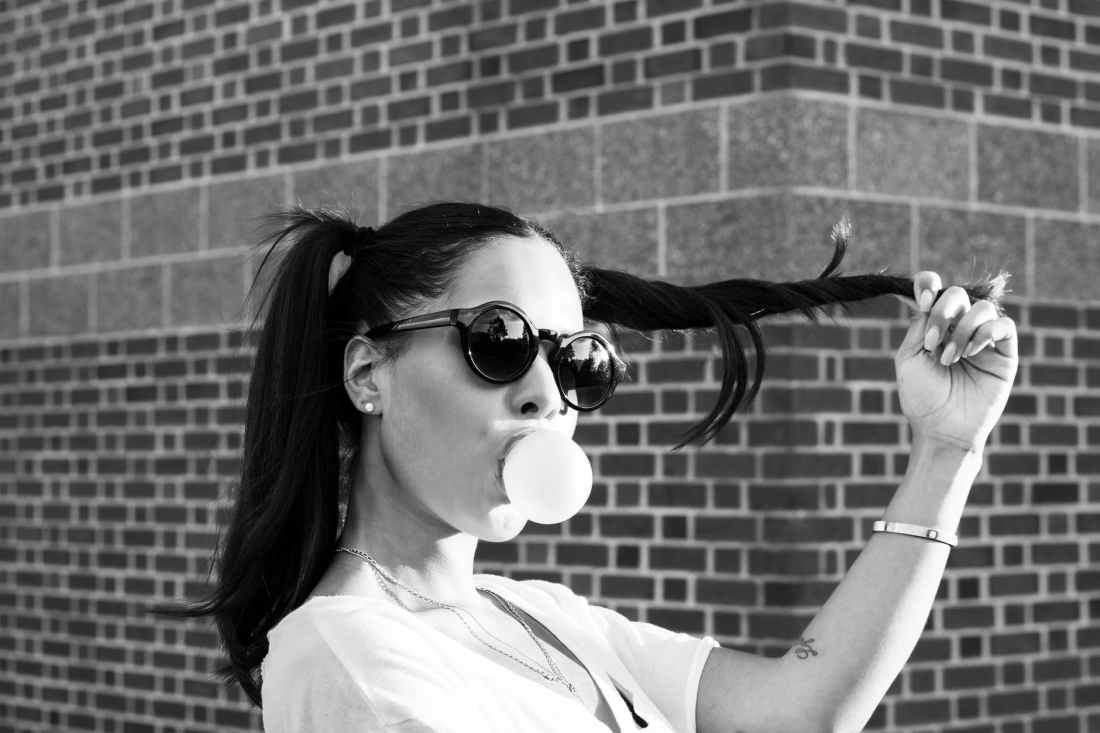 woman blowing bubble gum